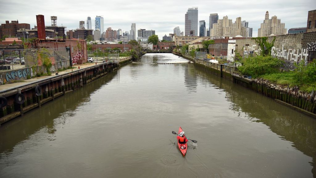 Person canoeing in the Gowanus Canal