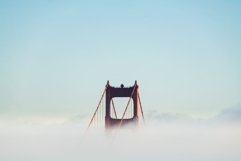 Golden Gate Bridge in San Francisco with fog surrounding it