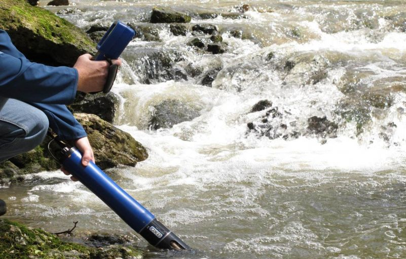 A researcher uses a multi-parameter sonde to test water quality