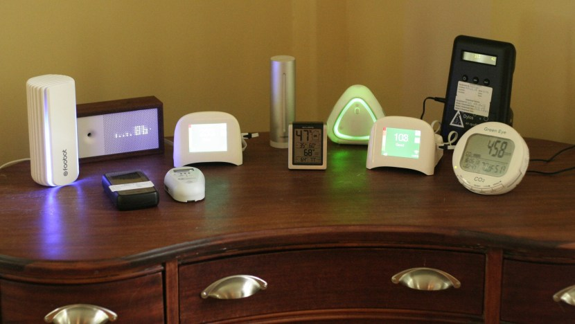 An array of air quality monitors on a dresser.