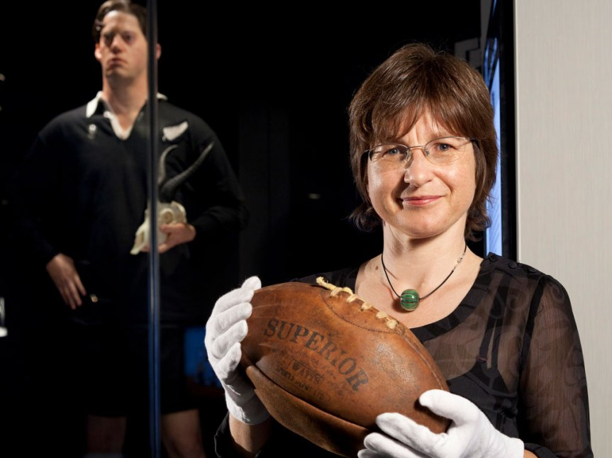 Kirstie Ross holding a rugby ball