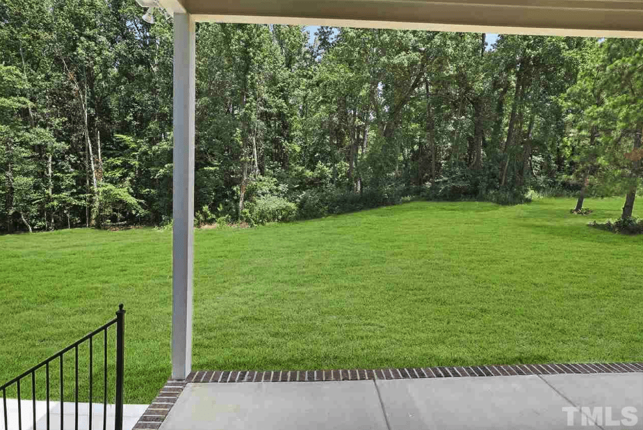 large backyard with covered patio