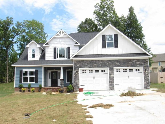 beautiful exterior of 46 oak hollow court in clayton.