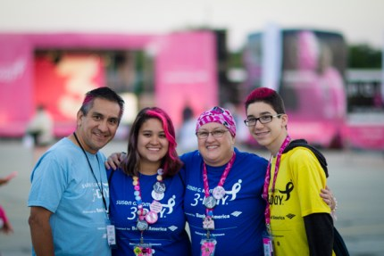Saralyn Carrillo stands on stage at the Opening Ceremony of Chicago's 2013 Susan G. Komen 3-Day®