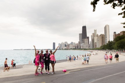 Downtown Chicago looms in the distance as a Komen 3-Day® team walks along the Lake