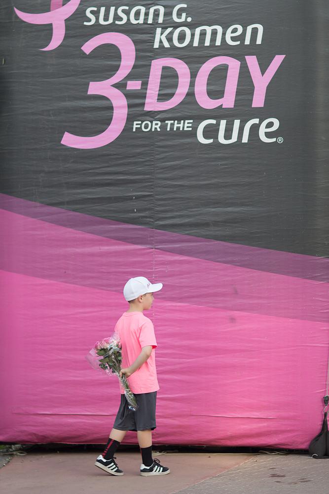 Little boy with flowers Susan G. Komen -Day Breast Cancer Walk