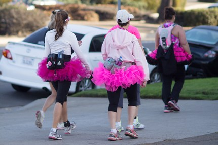 Julie and Jorden in traditional pink tutus, take on the San Diego 3-Day route on the final day of walking