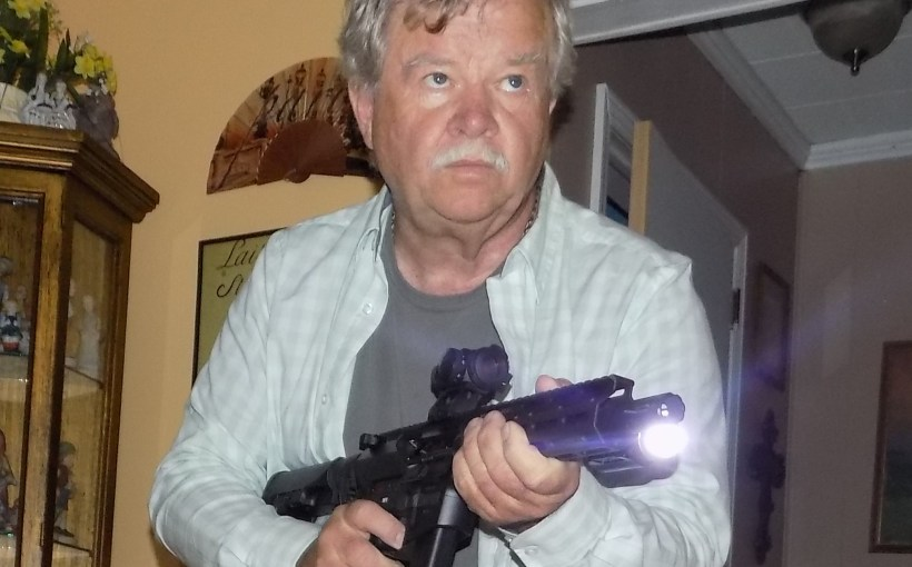 Bob Campbell holding an ar-15 pistol with tactical light
