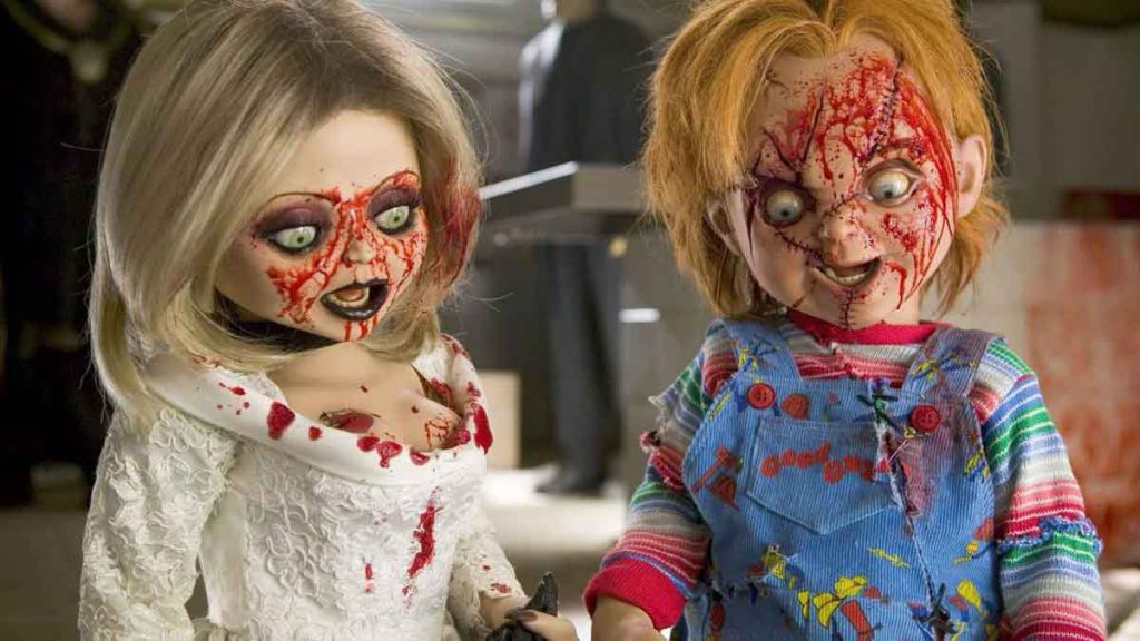 Scene from Bride of Chucky movie featuring both Chucky the doll and his bride.
