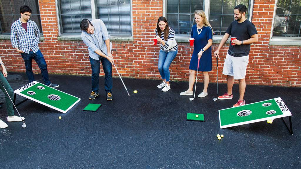 Friends palying Chippo Golf in their driveway