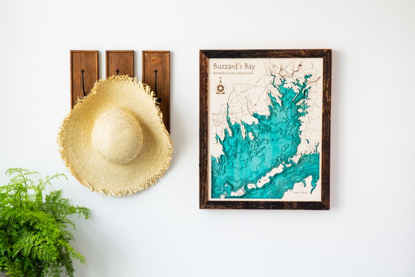 A 3D lake art map of Buzzard's Bay hangs on a wall of a home