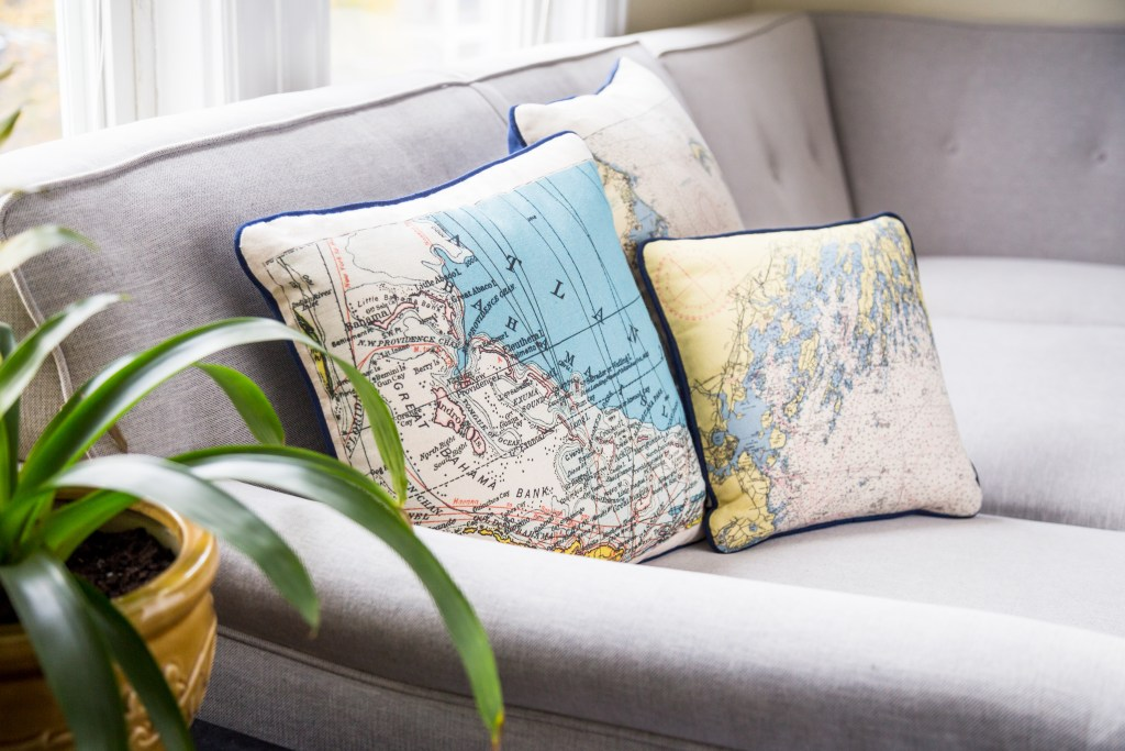 Custom nautical pillows from Not For Navigation are a great living room accent