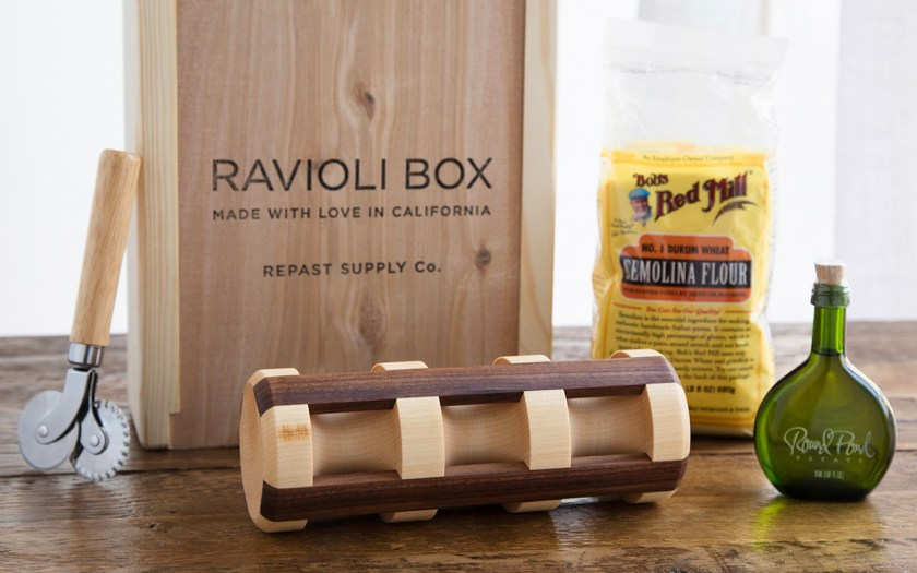 A ravioli making kit from Repast Supply Company is seen with a handcrafted ravioli pin and the ingredients to make homemade ravioli