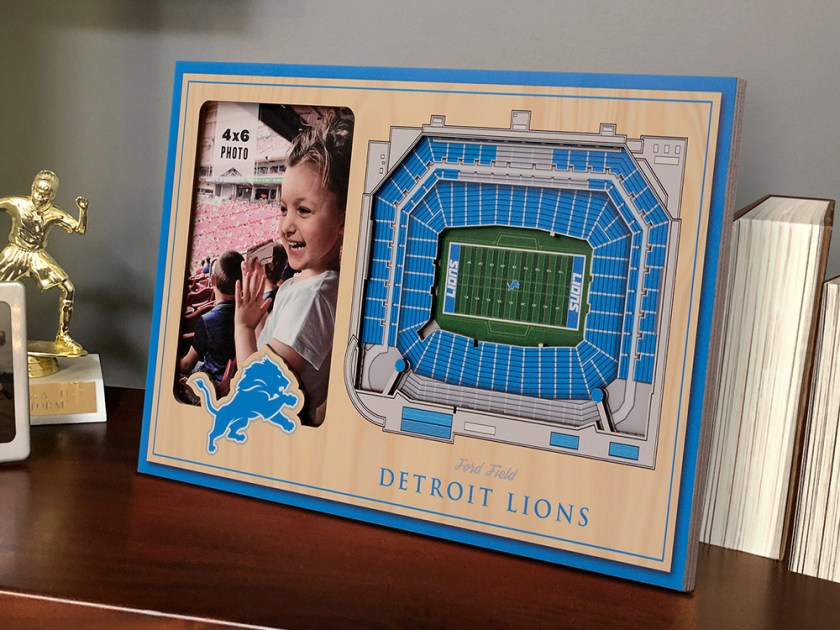 A photo of a little girl at a stadium sits framed in a Detroit Lions 3D stadium picture frame from StadiumViews