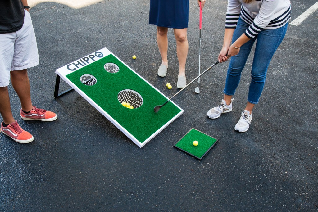 A group of friends plays Chippo Golf in their driveway