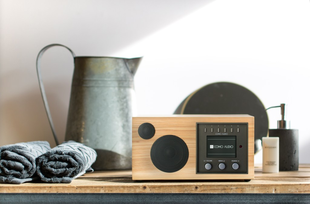 A retro-looking smart connected hi-fi speaker system from Como Audio sits on the counter in a bathroom