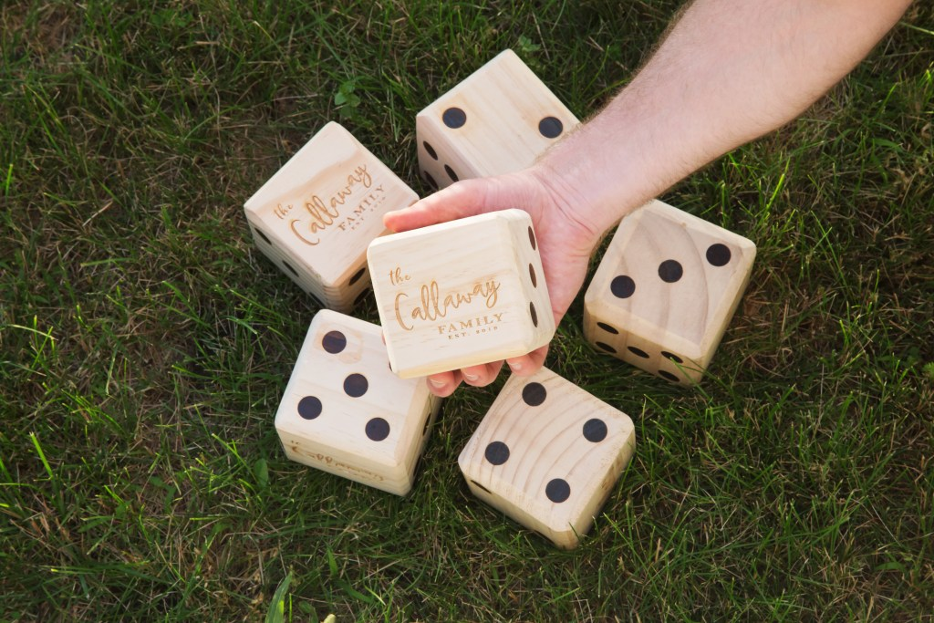 Giant wooden yard dice from Yard Games can be seen personalized by The Callaway family
