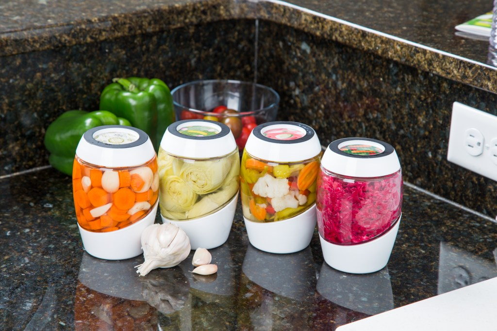 A myriad of vegetables sit in 4 individual fermentation crocks from Mortier Pilon