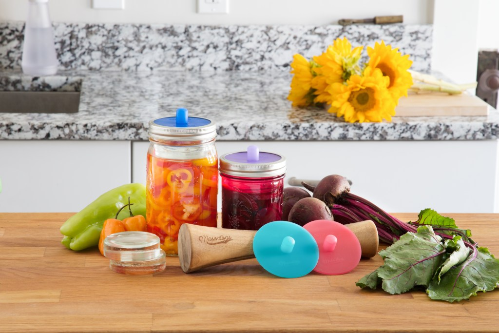 Beets and peppers sit on a counter next to Masontops' fermentation kit