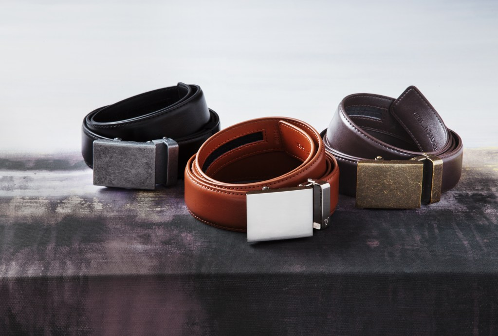 3 fully-adjustable leather belts from Mission Belt sit on a counter
