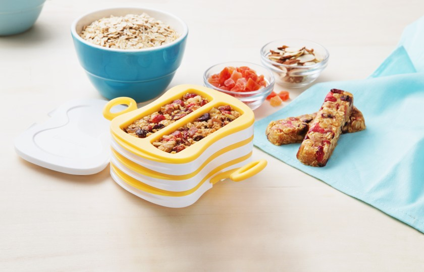 Healthy homemade granola bars are molded in a granola bar press from Tescoma