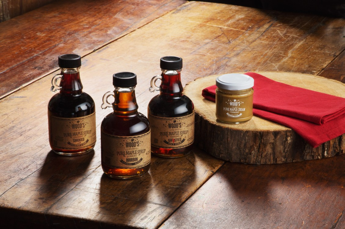 Bottles of pure maple syrup & maple cream from Wood's Maple Syrup sit on a kitchen counter