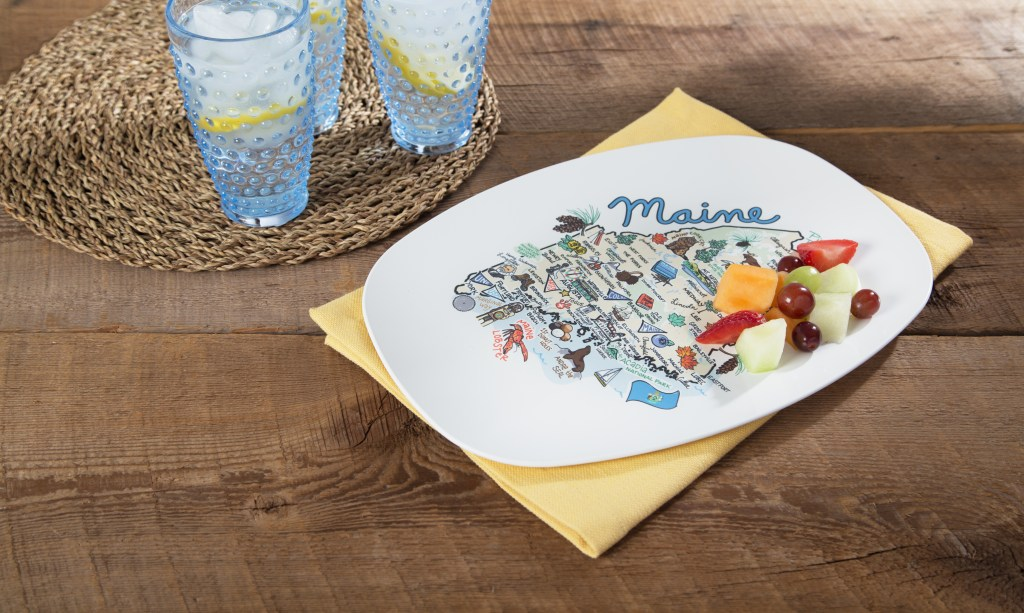 Fruit salad sits on a Maine-inspired map plate from Fish Kiss