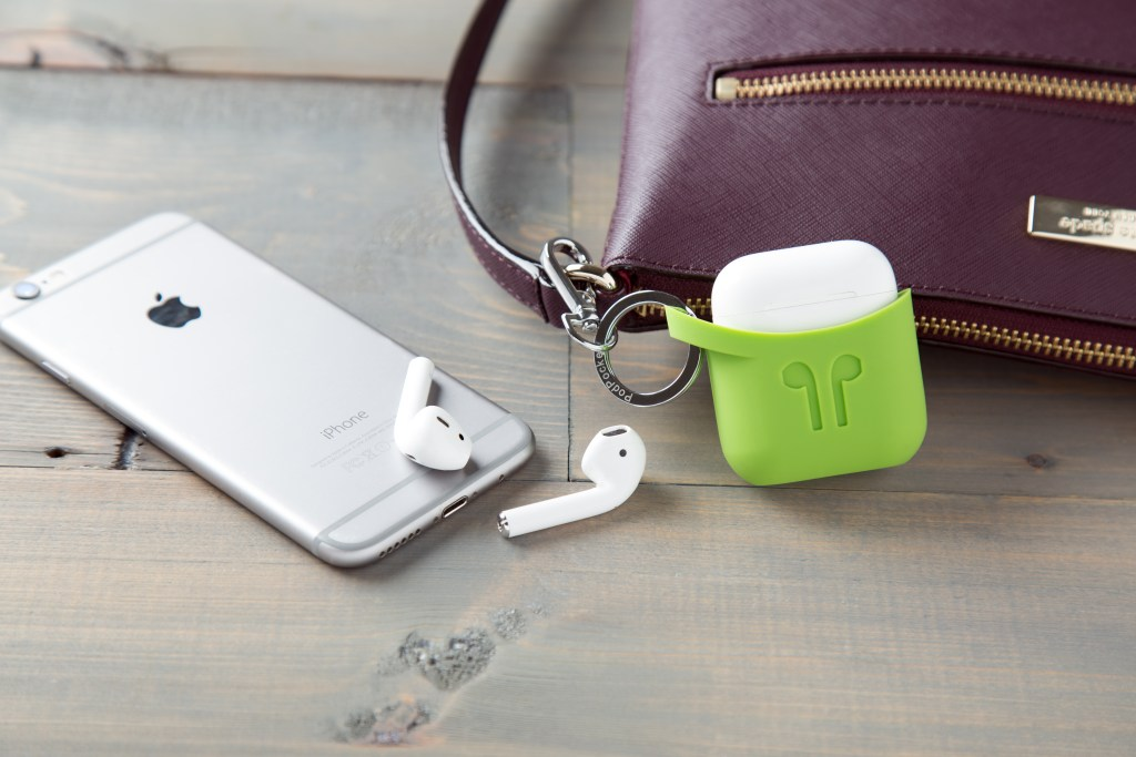 A lime green PodPocket is seen hooked to a purse, keeping AirPods within reach