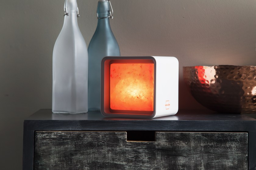 A Himalayan pink salt lamp cube from ZenCube sits on a bureau