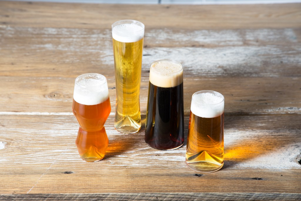 4 different styles of beer sit in pint glasses styled for each style from Sempli