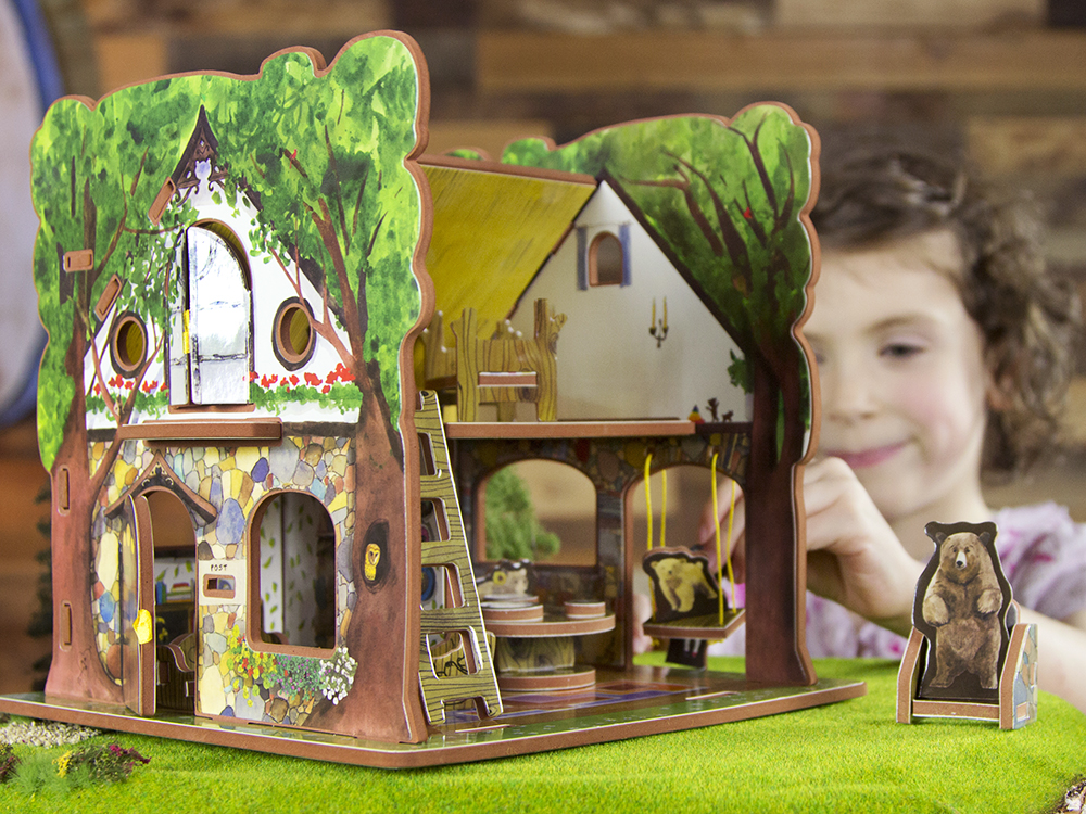 A little girl is seen playing with her Goldilocks & the Three Bears 3D toy house from Storytime Toys