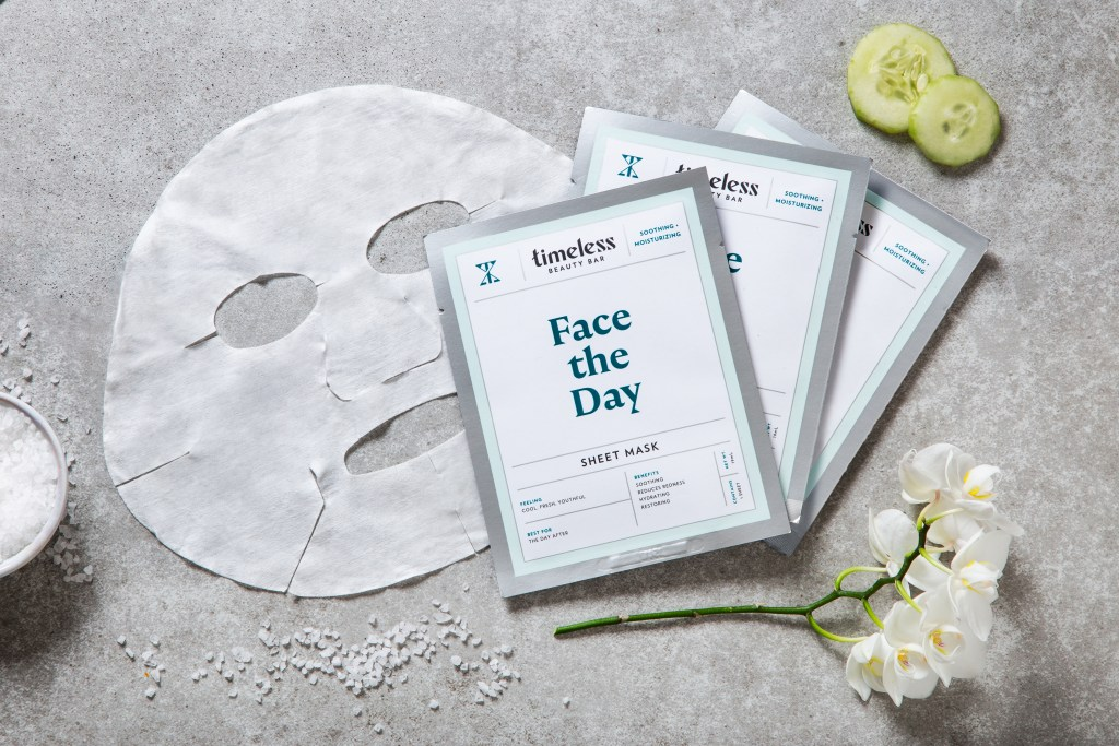 Three Face the Day sheet masks from Timeless Beauty Bar lay on a table