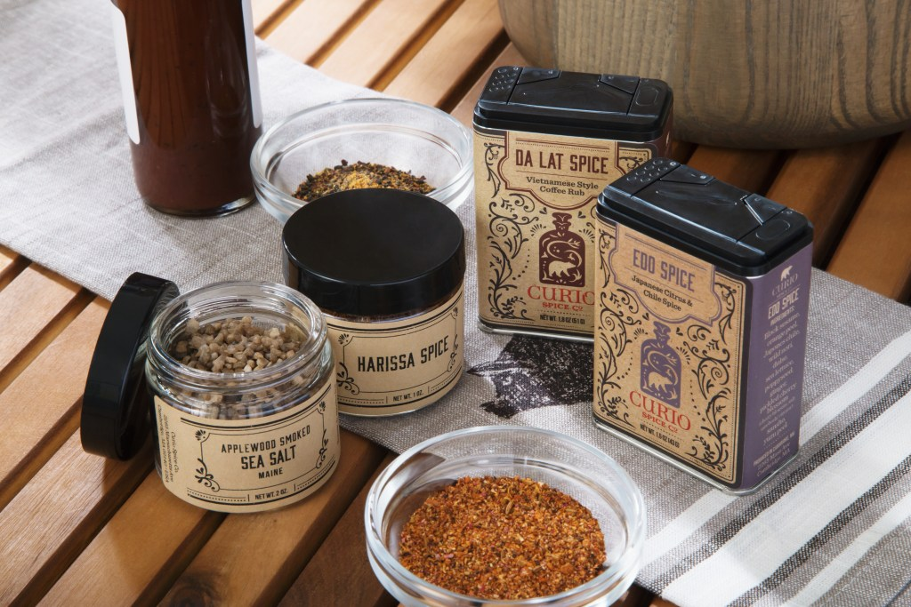 A variety of grilling spice blends from Curio Spice Co. are seen on a kitchen table
