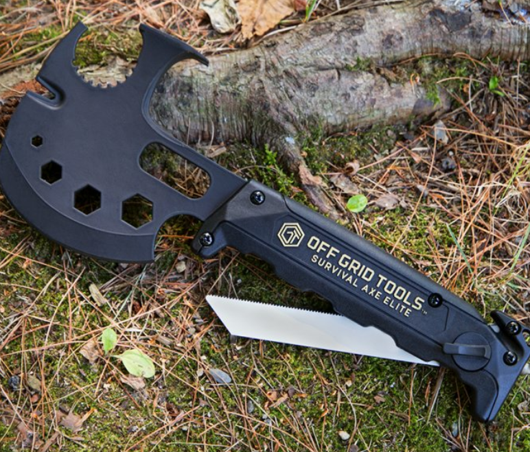 A black Survival Axe from Innovation Factory sits on the ground