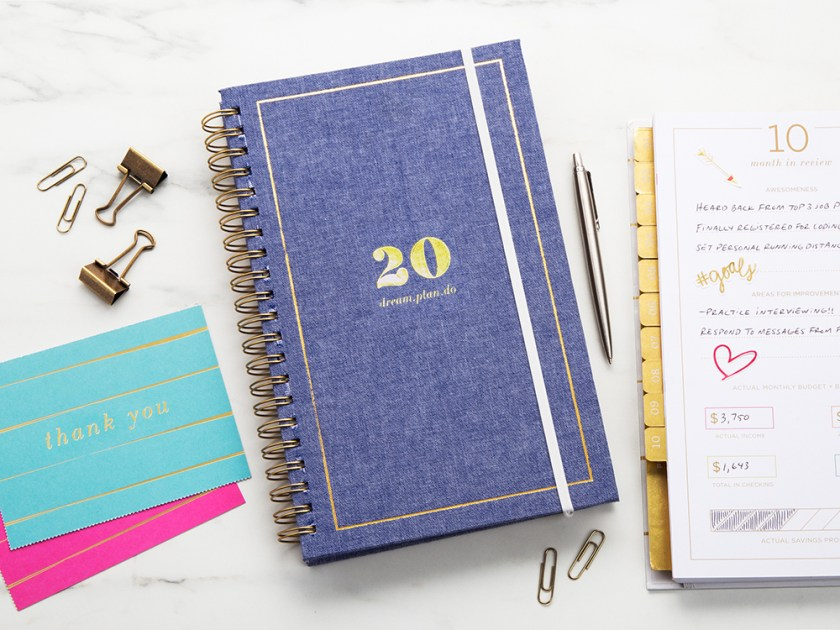 A 2020 inspirational planner from lake + loft is seen with thank you cards, paperclips and a pen