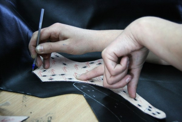 A design pattern is being cut for bespoke tailoring