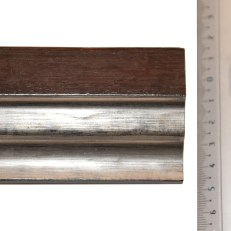 Wide dark wood frame with wide bevelled silver inner edge.