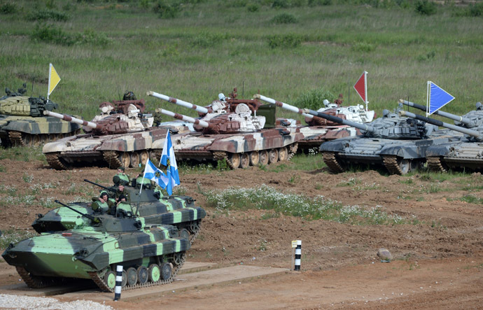 2453016 06/25/2014 BMD-4M armored infantry fighting vehicles and T-72B tanks during Tank Biathlon 2014 competition held at the shooting range of the 2nd Guards Motor Rifle Tamanskaya Division in Alabino village. Kirill Kallinikov/RIA Novosti