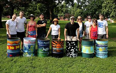 The proud artists pose with their work. Photo credit: Brian Schneider, www.ebrianschneider.com