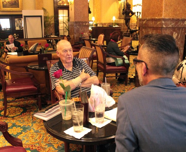 Look at that sly smile. His wife still didn't know why they were at The Pfister!