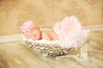 baby in a basket in sweet tutu