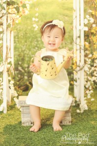 Best-First-Birthday-Photographer-One-Year-Old-Girl-Studio-Grass-Set-Sun-Glow-Garden-Spring-Styled-Brentwood