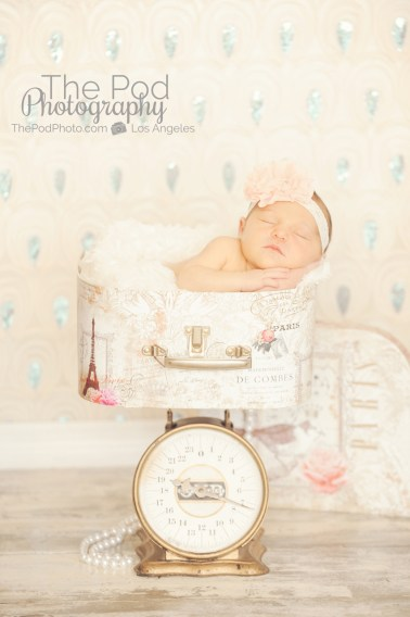 infant-on-scale-newborn-photo