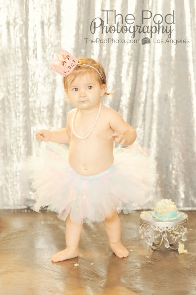 Best-First-Birthday-Cake-Smash-Photographer-Los-Angeles-SusieCakes-Teal-White-SIlver-Pink-Standing-Cute-Westwood