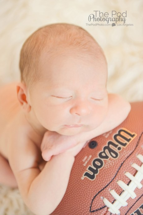 baby-asleep-on-football-santa-monica
