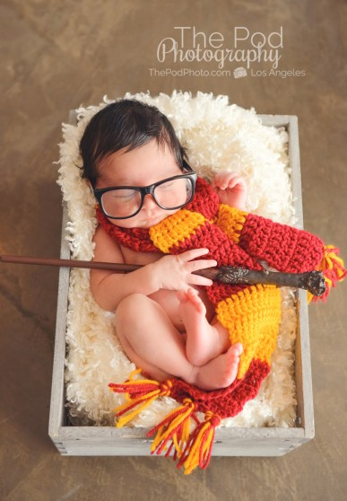 harry-potter-newborn-holding-magic-wand