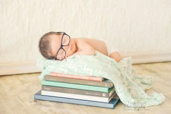 nerd-baby-alseep-on-books