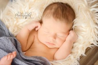 cuddled-up-baby-boy-at-photo-studio