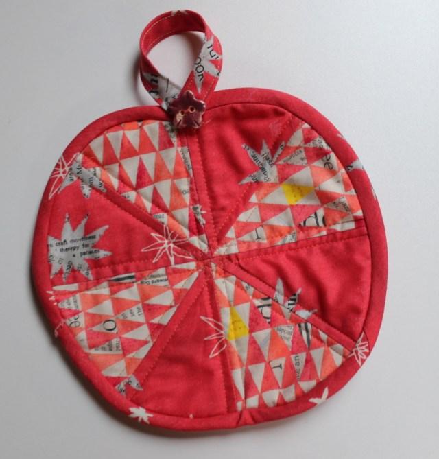 apple potholder with ceramic button