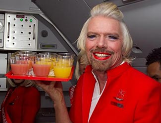 Should we worry?  Only a couple of weeks ago Sir Richard Branson showed us what he wears underneath his kilt.  This week, he indulges in a bit of cross dressing on a competitor's airline.